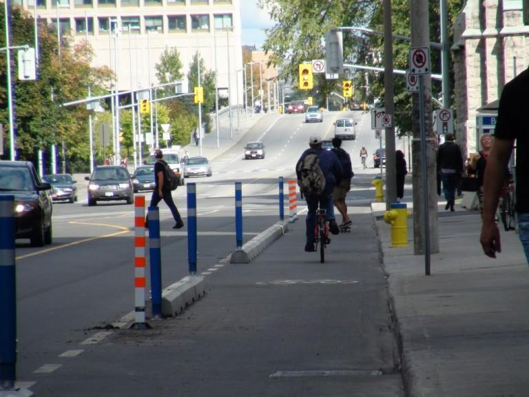 Laurier Bike Lane photo by David Chernushenko, courtesy http://bikecitythemovie.ca/